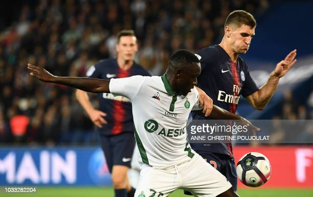Saint-Etienne's Senegalese midfielder Assane Diousse vies for the ball with Paris Saint-Germain's Belgian defender Thomas Meunier during the French...
