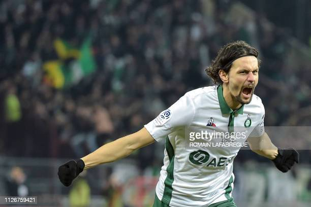 SaintEtienne's Serbian defender Neven Subotic celebrates after scoring a goal during the French L1 football match between Dijon and SaintEtienne on...