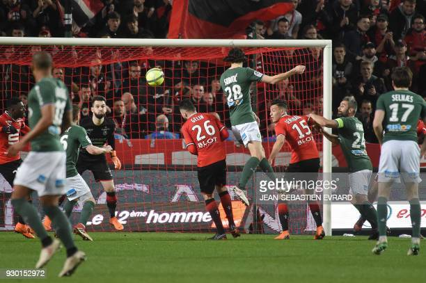 SaintEtienne's Serbian defender Neven Subotic heads the ball as he scores a goal during the French L1 football match between Rennes and SaintEtienne...