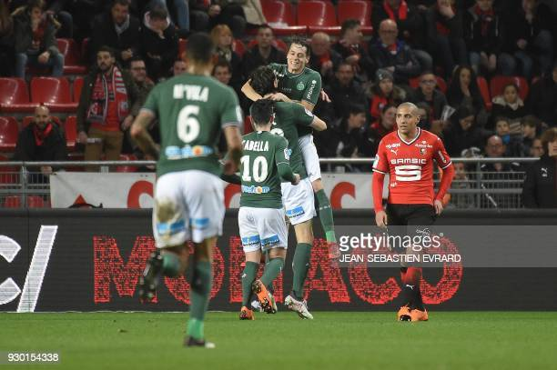 SaintEtienne's Serbian defender Neven Subotic is congratulated by his teammates after scoring during the French L1 football match between Rennes and...