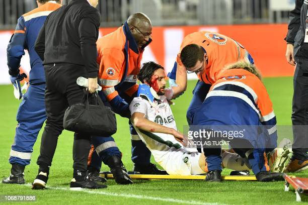 Saint-Etienne's Serbian defender Neven Subotic receives medication after being injured during the French L1 football match between FC Girondins de...