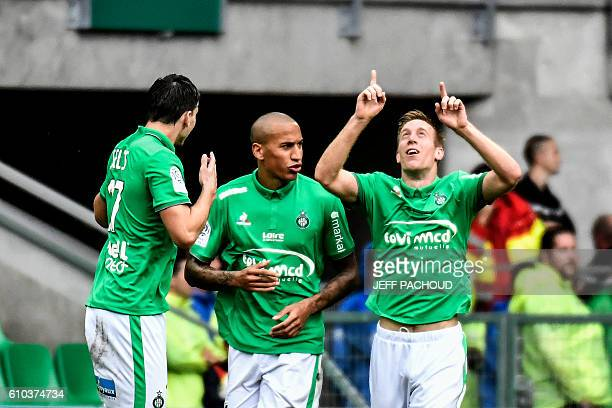 SaintEtienne's Slovenian forward Robert Beric celebrates with his teammates after scoring a goal during the French L1 football match AS SaintEtienne...