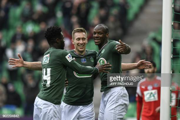 SaintEtienne's Slovenian forward Robert Beric celebrates with his teammates after scoring a goal during the French Cup football match Saint Etienne...