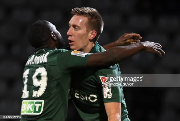 Saint-Etienne's Slovenian forward Robert Beric is congratulated by Saint-Etienne's French midfielder Yannis Salibur after scoring during the French...