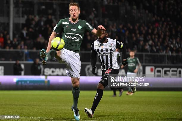 SaintEtienne's Slovenian forward Robert Beric vies with Angers' Ivorian defender Ismael Traore during the French L1 football match between Angers and...