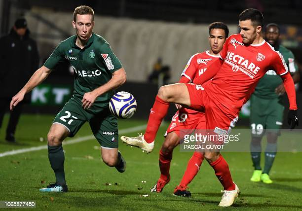 Saint-Etienne's Slovenian forward Robert Beric vies with Nîmes' French midfielder Antonin Bobichon during the French League Cup round of 16 football...
