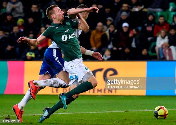 SaintEtienne's Slovenian forward Robert Beric vies with Strasbourg's Serbian defender Stefan Mitrovic during the French L1 football match between...