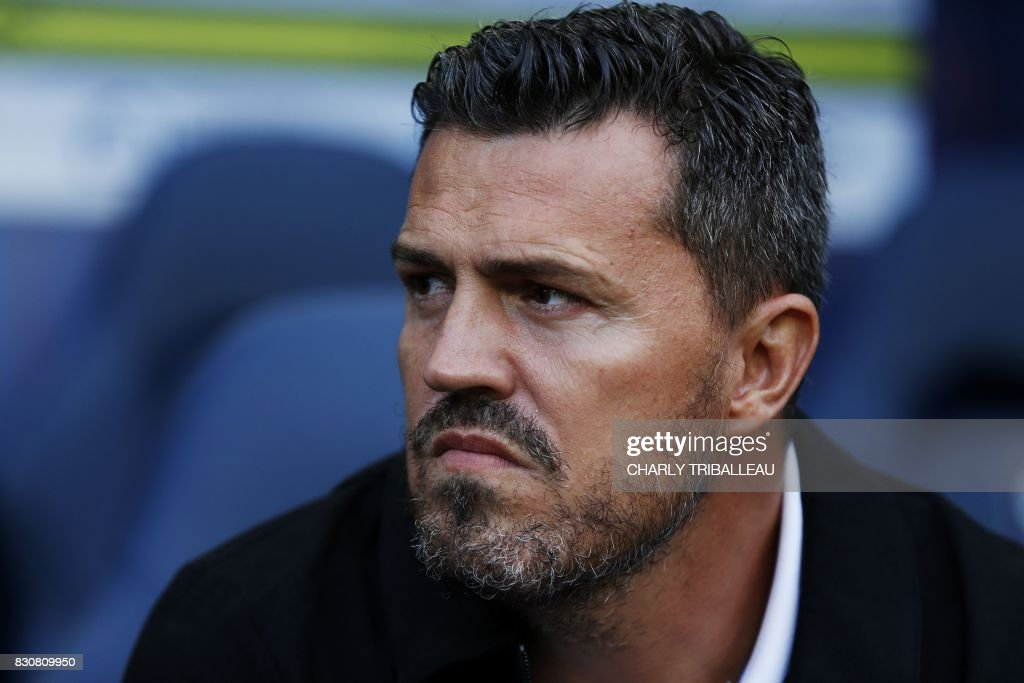 Saint-Etienne's Spanish head coach Oscar Garcia looks on prior to the French L1 football match between Caen (SMC) and Saint-Etienne (ASSE) on August 12, 2017, at the Michel d'Ornano stadium, in Caen, northwestern France. /