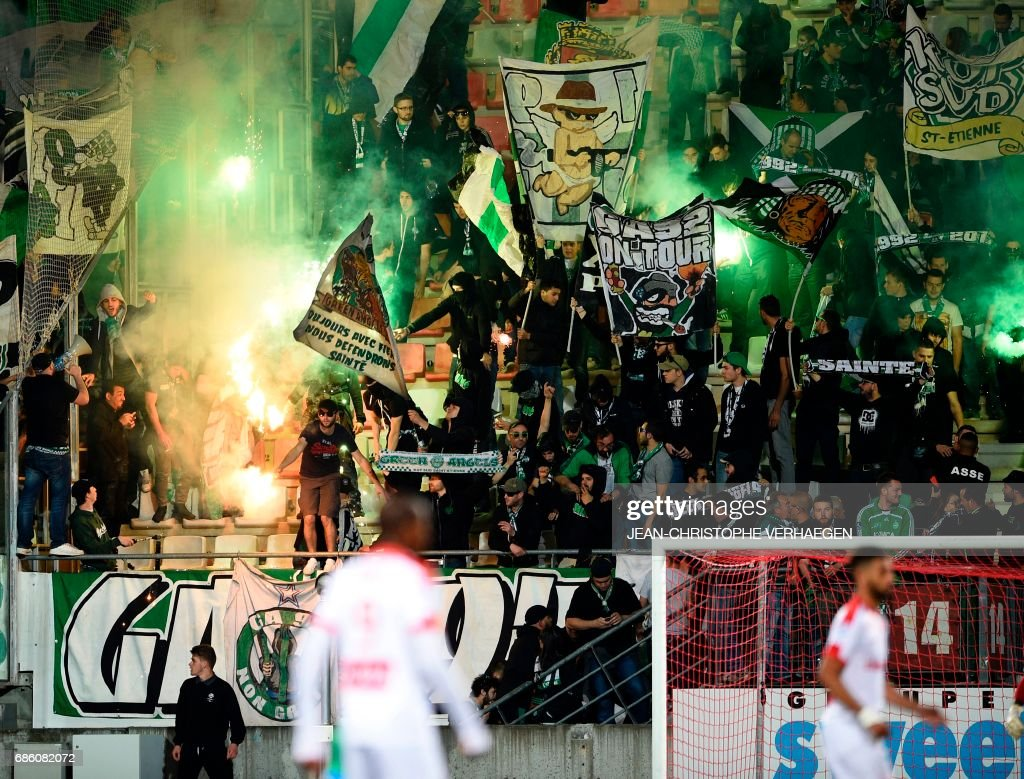 Saint-Etienne's supporters celebrate during the French L1 football match between Nancy (ASNL) and Saint-Etienne (ASSE) on May 20, 2017 at Marcel Picot stadium in Tomblaine, eastern France. /