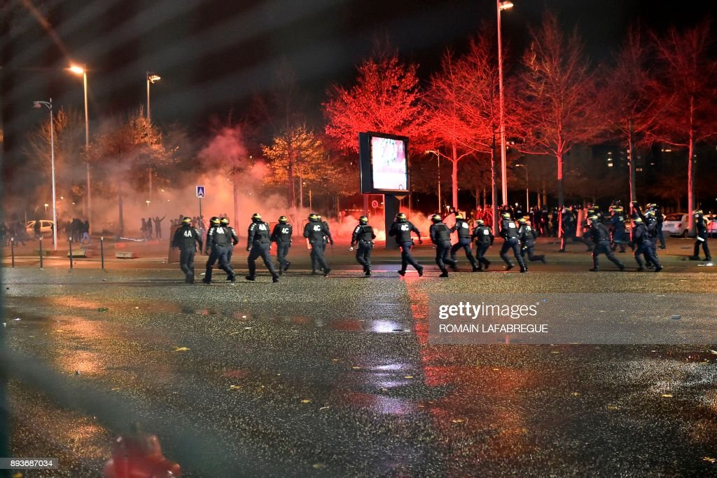 Saint-Etienne's supporters clash with police following the French L1 football match between Saint-Etienne (ASSE) and Monaco (ASM) on December 15, 2017, at the Geoffroy Guichard stadium in Saint-Etienne, central-eastern France. /