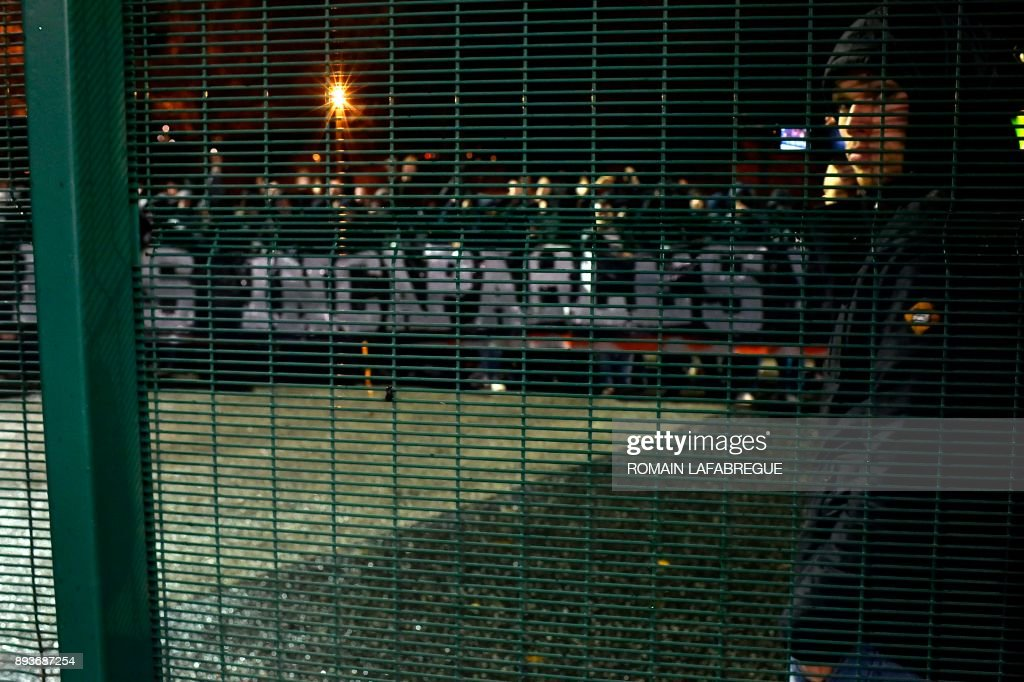 Saint-Etienne's supporters with a banner reading 'incapable' following the French L1 football match between Saint-Etienne (ASSE) and Monaco (ASM) on December 15, 2017, at the Geoffroy Guichard stadium in Saint-Etienne, central-eastern France. /