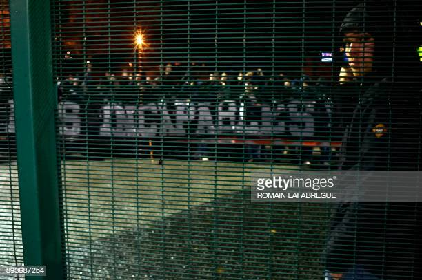 SaintEtienne's supporters with a banner reading 'incapable' following the French L1 football match between SaintEtienne and Monaco on December 15 at...
