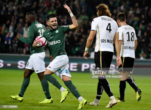 SaintEtienne's team players celebrate after scoring a goal during the French L1 football match between SaintEtienne and Angers on November 4 at the...