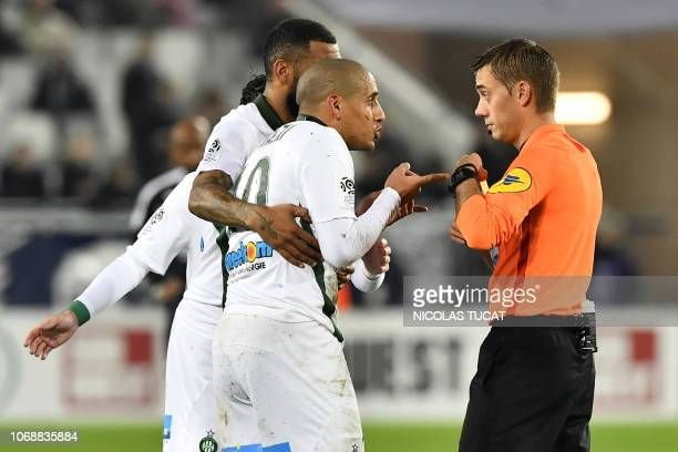 Saint-Etienne's Tunisian midfielder Wahbi Khazri argues with French referee Clement Turpin during the French L1 football match between FC Girondins...