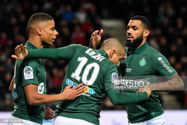 SaintEtienne's Tunisian midfielder Wahbi Khazri is congratulated by his teammates after scoring during the French L1 football match between Guingamp...