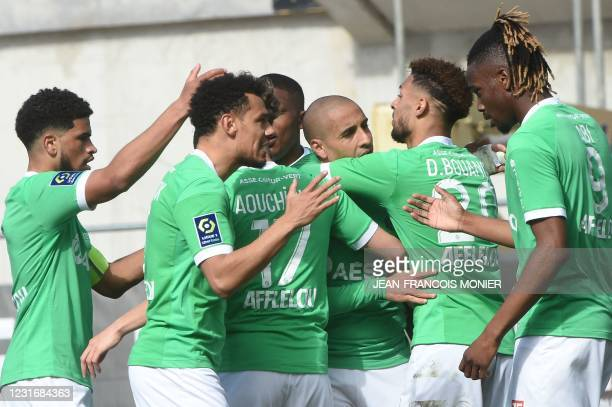 Saint-Etienne's Tunisian midfielder Wahbi Khazri is congratulated by his teammates after scoring during the French L1 Football match between Angers...