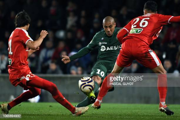 Saint-Etienne's Tunisian midfielder Wahbi Khazri kicks the ball during the French League Cup round of 16 football match between Nimes Olympique and...