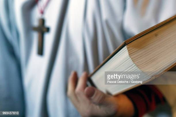 saint-jacques church.  catholic mass.  altar boy with lectionary.  sallanches. france. - sallanches stock pictures, royalty-free photos & images