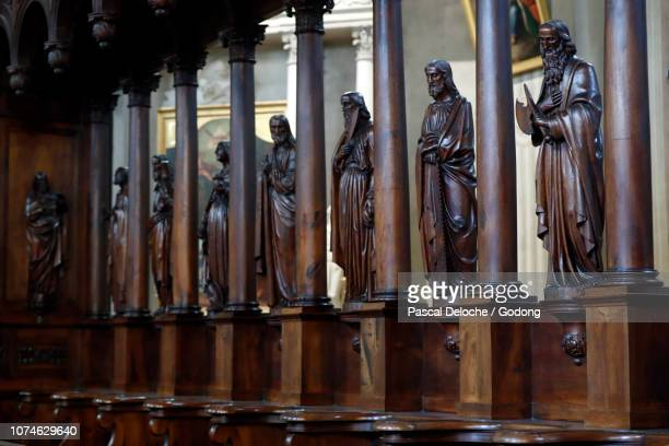 saint-jacques church.  choir stalls and staues. sallanches. france. - sallanches stock pictures, royalty-free photos & images