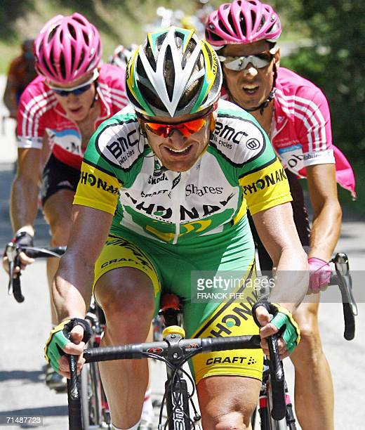 Saint-Jean-de-Maurienne, FRANCE: USA's Floyd Landis starts his breakaway from Germany's Andreas Kloden and Australia's Michael ROgers during the...