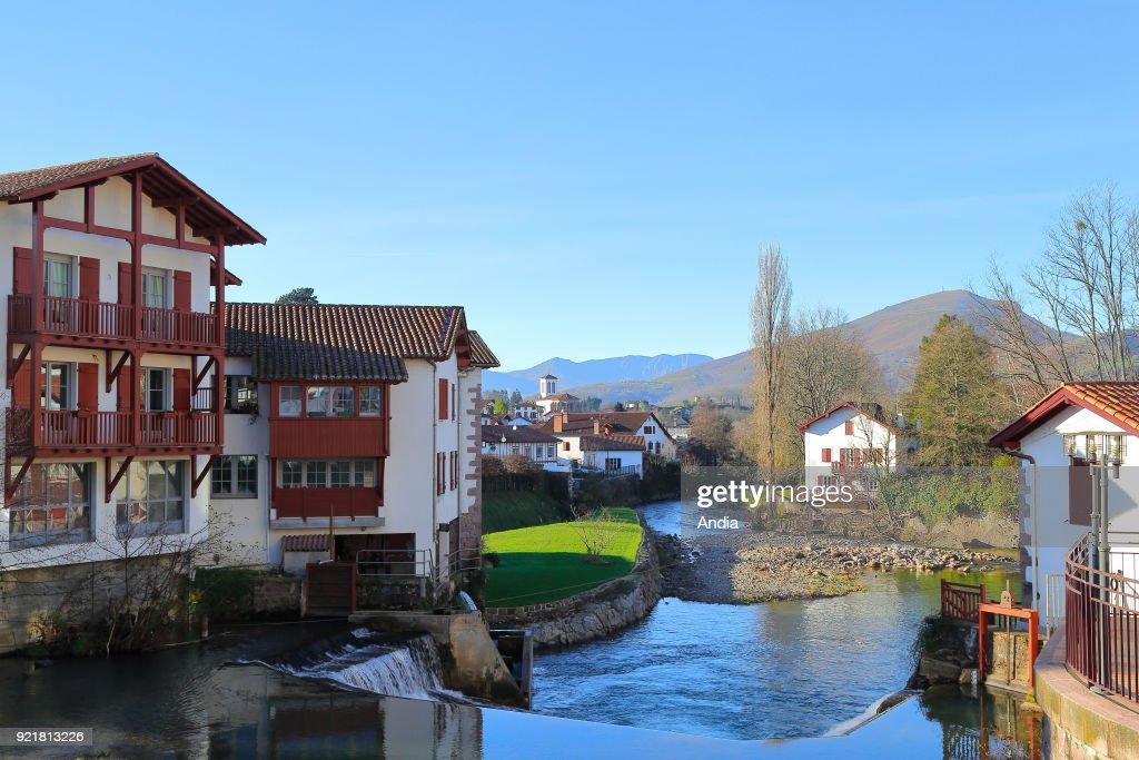 Saint-Jean-Pied-de-Port, in the Basque Country. The Nive de Beherobie river and the village. Saint-Jean-Pied-de-Port is a stage along the Route of Santiago de Compostela (or Way of Saint James).