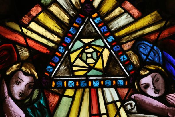 Saint-Joseph church. Stained glass window. The tetragrammaton.