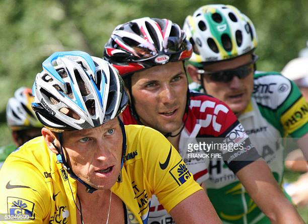 Lance Armstrong rides alongside with Italian Ivan Basso and US Floyd Landis during the 15th stage of the 92nd Tour de France cycling race between...