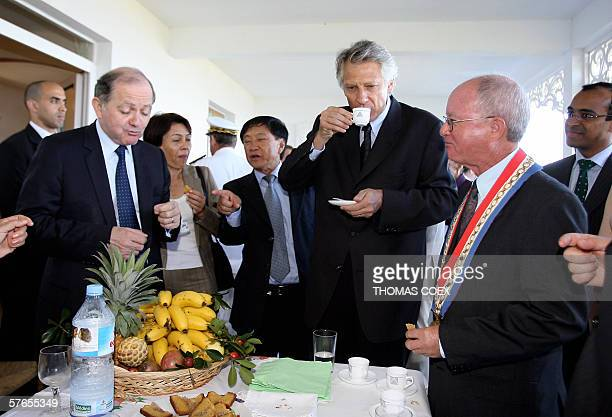 French Prime Minister Dominique De Villepin and Research and High school Minister Francois Goulard drink a cup of coffee with cottage owners during a...