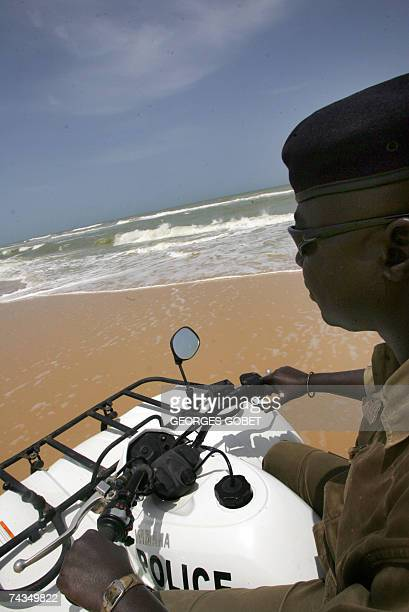 A Senagalese police officer rides a fourwheeled motorbike 27 May 2007 during a patrol on a beach near the northern city of SaintLouis Since July 2006...