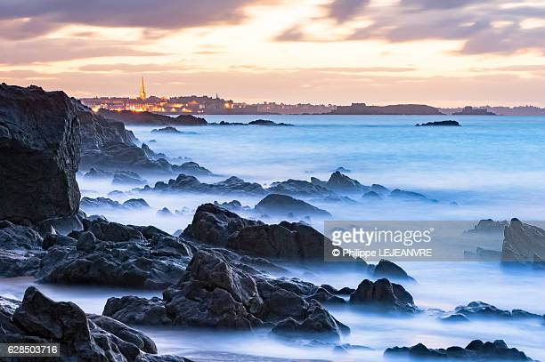 Saint-Malo after sunset with rock and sea long pose