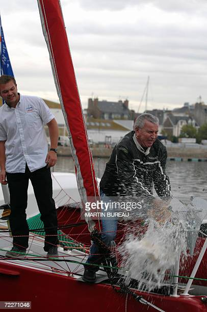 French singer Bernard Lavilliers baptizes Loic Escoffier's multihulls boat Delage Diazo by breaking a bottle of champagne on it 26 October 2006 in...