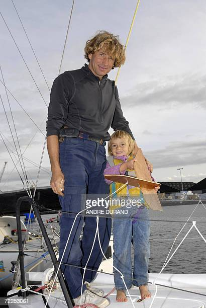 French skipper Joe Seeten poses with his daughter on his Class 40 monohull TMI Technologie 24 october 2006 in SaintMalo Britanny Seeten will...