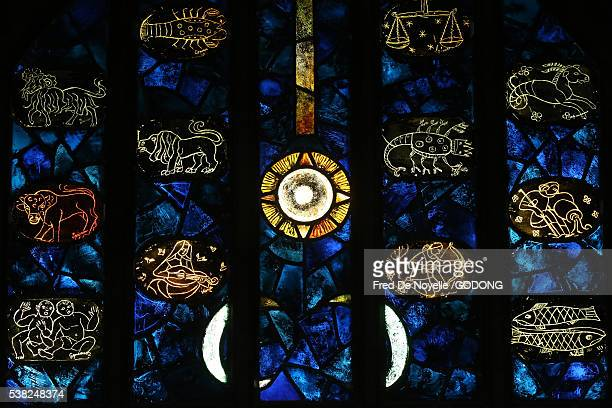 saint-maurice d'agaune abbey. stained glass window. astrological signs. - astrology stock pictures, royalty-free photos & images