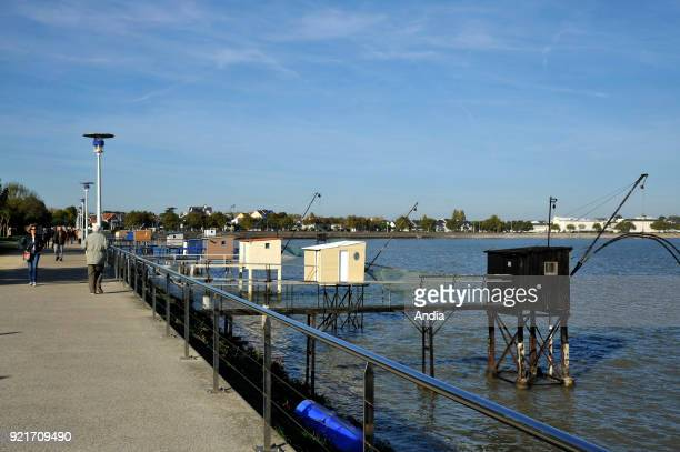 walk along the fishing spots and Boulevard Albert 1er Walkers with a fishing hut and a square dipping net