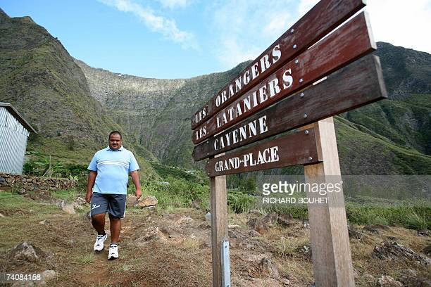 A man walks on the path to the Ilet des Orangers mountain village only accessible by foot or helicopter on the French Indian territory island of La...