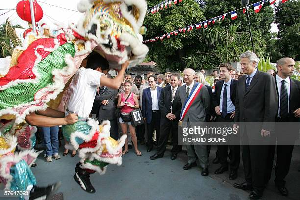 Chinese people dance in front of French Prime Minister Dominique De Villepin and Overseas Territories minister Francois Baroin during their visit to...