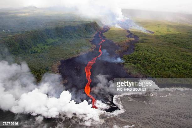 Aerial view taken 03 April 2007 near SaintPhilippe in La Reunion island of lava coming from the Piton de la Fournaise volcano burning vegetation and...