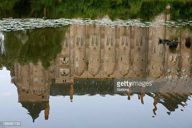 SaintPierre de Solesmes abbey reflected in the Sarthe river