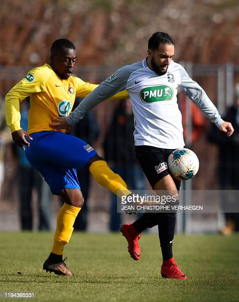 SaintPierroise's Imad Zaaouar vies with Epinal's David Luvualu during the French cup football match between Epinal and SaintPierroise on January 18...