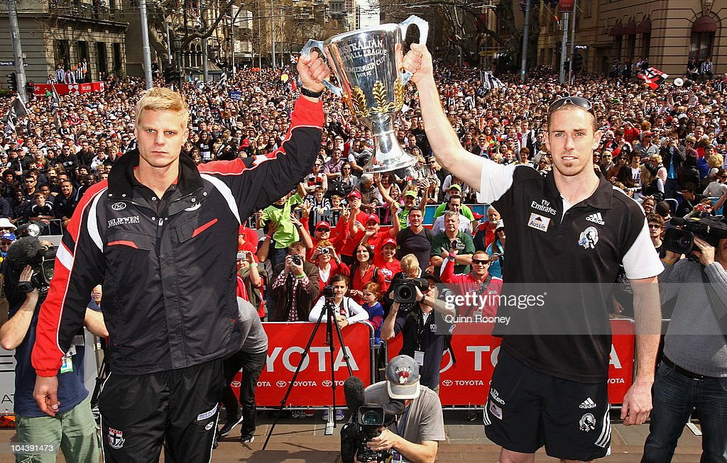 Saints captain Nick Riewoldt and Magpies captain Nick Maxwell hold the premiership cup aloft during the AFL Grand Final Parade on September 24, 2010 in Melbourne, Australia.