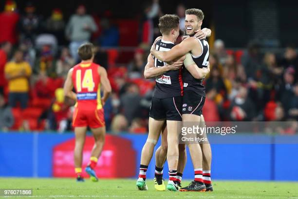 Saints celebrate winning the round 13 AFL match between the Gold Coast Suns and the St Kilda Saints at Metricon Stadium on June 16 2018 in Gold Coast...
