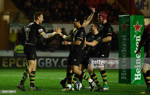 Saints centre Harry Mallinder celebrates after scoring the first try during the European Rugby Champions Cup match between Scarlets and Northampton...