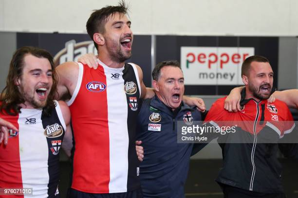 Saints coach Alan Richardson celebrates with players after winning the round 13 AFL match between the Gold Coast Suns and the St Kilda Saints at...
