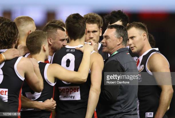 Saints coach Alan Richardson speaks to the players at the break during the round 23 AFL match between the St Kilda Saints and the North Melbourne...