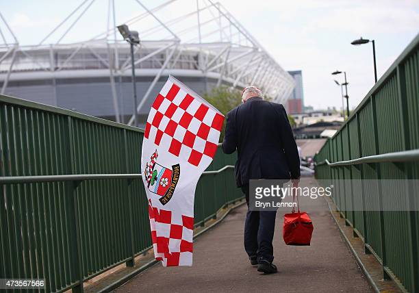 Saints fan carries a flag as he makes his way to the stadium ahead of the Barclays Premier League match between Southampton and Aston Villa at St...