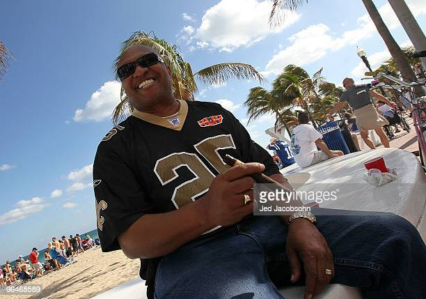 Saints fan Kenny Gibbs of Fort Lauderdale, smokes a cigar on Fort Lauderdale Beach on February 6, 2010 in Fort Lauderdale, Florida. Super Bowl XLIV...