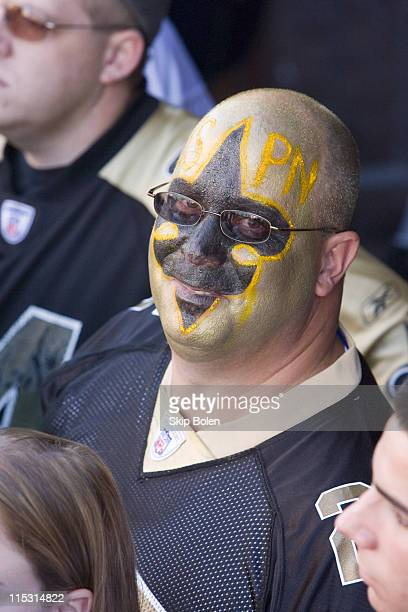 A Saints fan outside the Louisiana Superdome prior to the Monday Night Football game between the Atlanta Falcons and New Orleans Saints on September...
