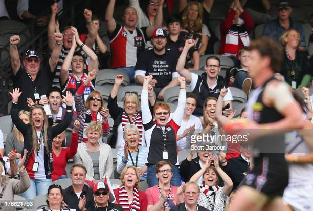 Saints fans celebrate as Justin Koschitzke of the Saints marks the ball and kicks a goal changed to a point on review during the round 23 AFL match...