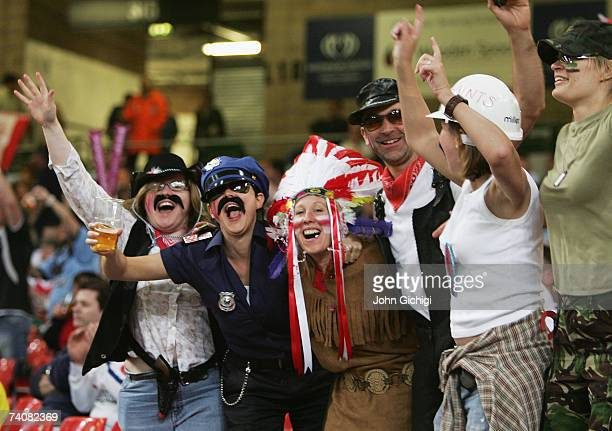 Saints fans dressed as the Village People celebrate their teams victory during the Engage Super League match between StHelens and Wigan Warriors at...