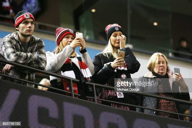 Saints fans show their support for Nick Riewoldt of the Saints during the round 22 AFL match between the St Kilda Saints and the North Melbourne...